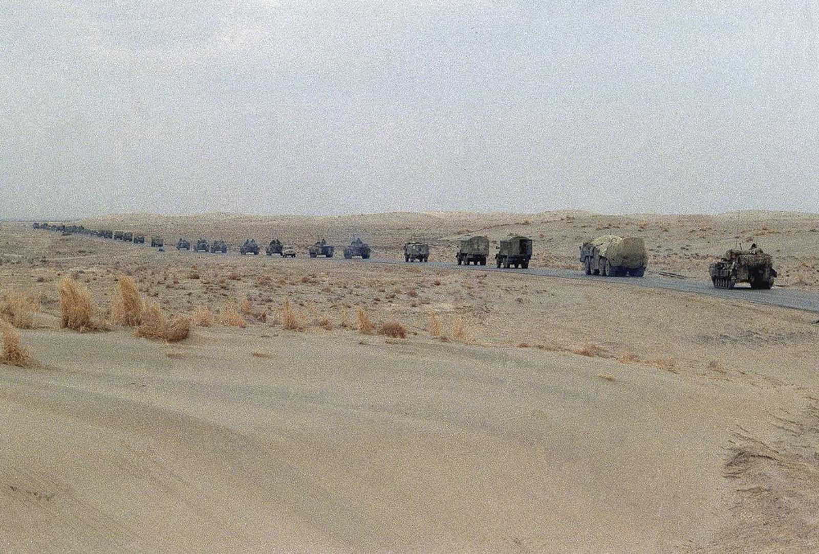 A column of Soviet armor and military trucks moves up the highway toward the Soviet border on February 7, 1989 in Hayratan. The convoy came from the Afghan capital Kabul as part of the withdrawal of Soviet soldiers.