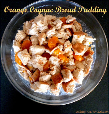 Orange Cognac Bread Pudding is a simple crockpot recipe featuring orange cognac, a little white chocolate and a hint of cinnamon. | Recipe developed by www.BakingInATornado.com | #recipe #crockpot #dessert