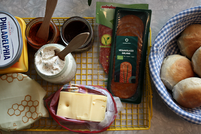 Home-made sandwich spreads and round breads. Here with vegan salami.