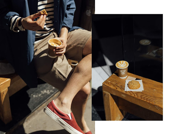 syra speciality coffee shop design store in barcelona, city guide, wearing joseph pleated shorts and vans red suede slip ons