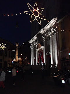 The Chiesa di Sant'Alessandro in Colonna lit up for the Festa along with the Roman column
