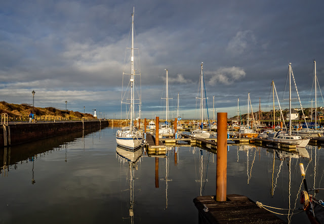 Photo of sun breaking through the clouds at Maryport Marina on Monday