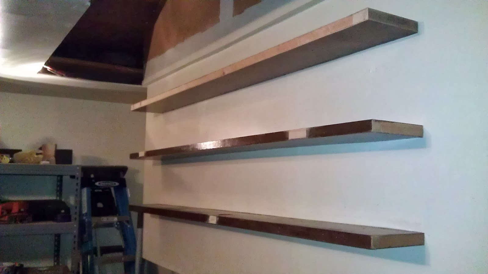 The Amos School of Construction: The Floating Garage Shelves