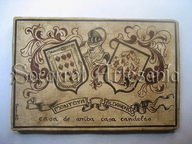 Yelmo, doble escudo y cinta con los apellidos. Socarrat Artesanía. Soc-Art. Camateu