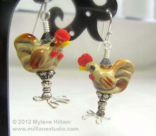 Pair of cute chicken earrings made from lampwork chicken beads with wire to make the feet.