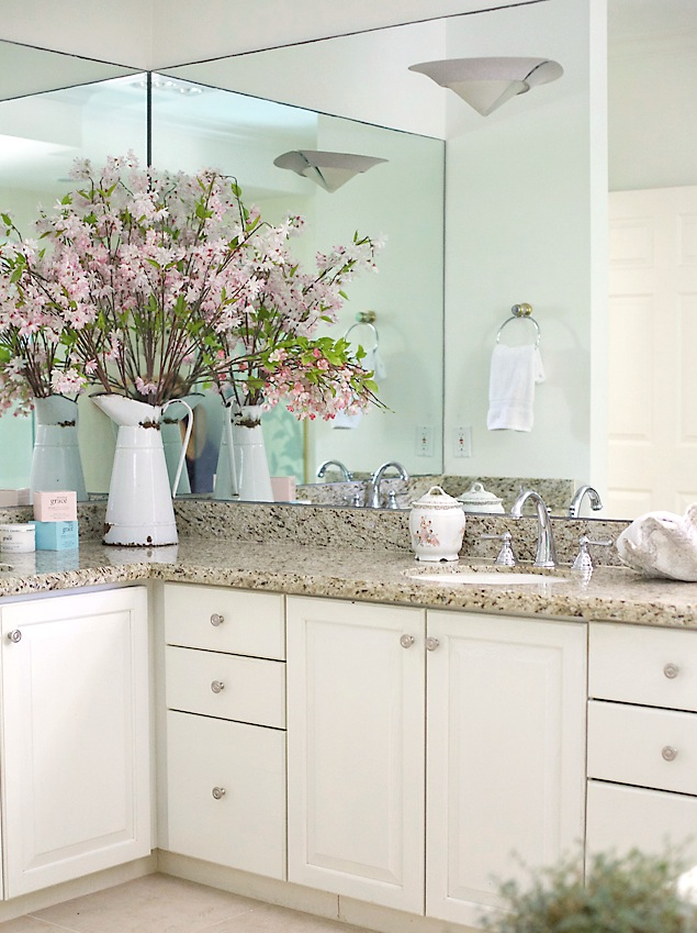 bathroom with white cabinets and granite counters