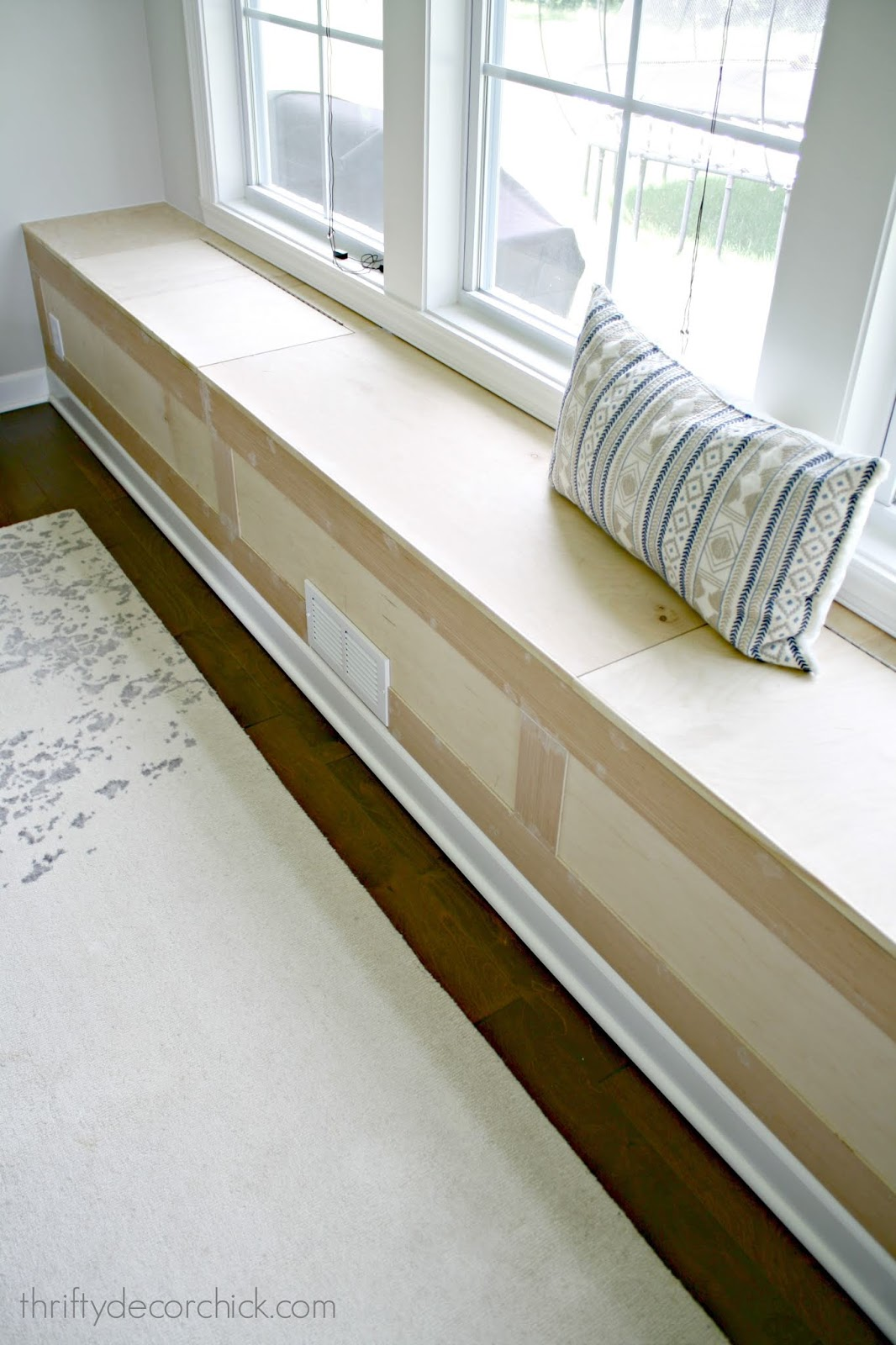 Long window seat with storage