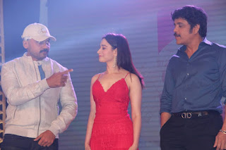 Actress Tamanna Pictures in Red Long Dress at Thozha Movie Audio Launch  0007