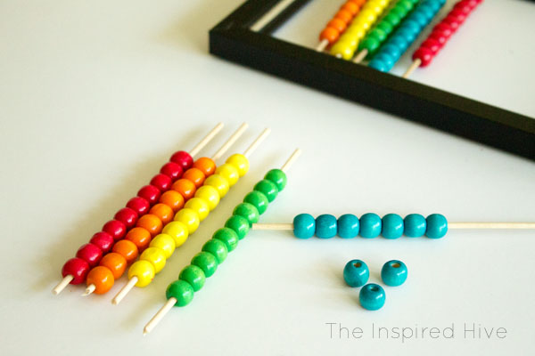 Such an easy craft! How to make your own DIY abacus wall decor. Great wall art idea for a kids room or playroom. #wallart