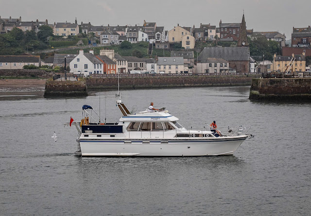 Photo of me preparing a docking stick as we approach the marina. Photo by Ronnie Bell
