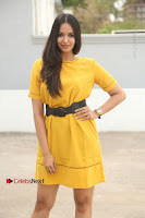 Actress Poojitha Stills in Yellow Short Dress at Darshakudu Movie Teaser Launch .COM 0341.JPG