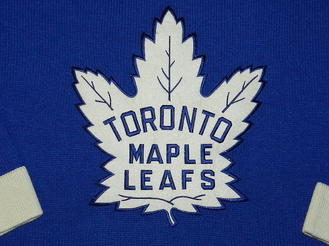 cc703ee76 LEAFS WORE THE ABOVE JERSEY DURING ROAD GAMES FROM 1963-64 TO THE END OF THE  1966-67 REGULAR SEASON. A REPLICA OF THIS DESIGN HAS SERVED AS THE CLUB S  ...