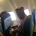 Rotimi Amaechi pictured flying economy class