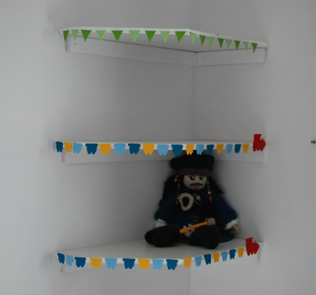 shelves with trim and knitted pirate