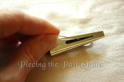 Take your straight pin and push the fabric toward the small end until it exits the tube.