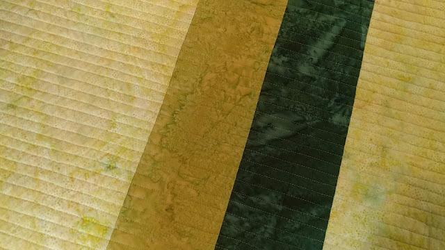 Modern batiks quilt as you go interleave quilt