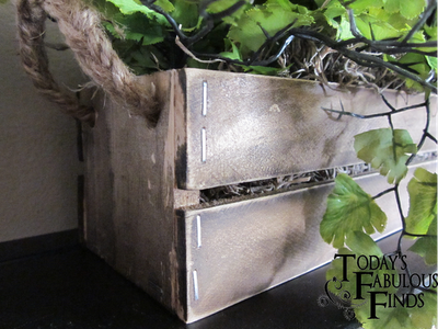 This plant box made of stained paint sticks is rustic for that farmhouse style.