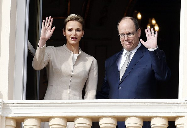 Princess Charlene Valentino leather boots, Akris dress, Dior pearl earrings