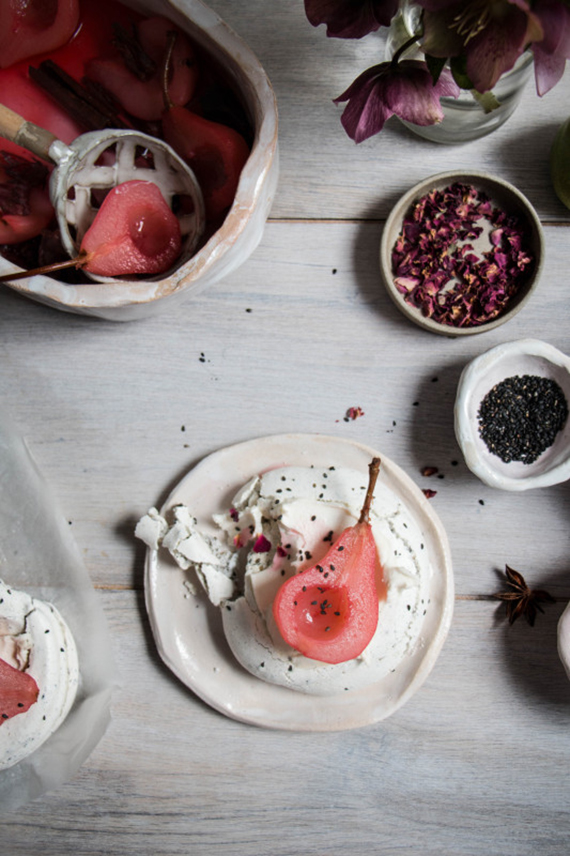 Spiced hibiscus poached pears in rose black sesame meringue nests recipe by Twigg Studios