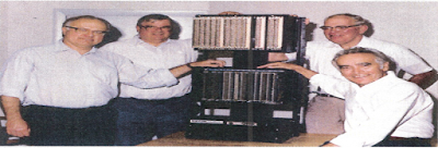 The picture shows some PLC Pioneers posing with the MODICON 084
