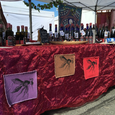 Celebrate the mosquito, if you must, at Holly's eye-catching market booth. (Photo by J. Besl / University of Alaska Anchorage)