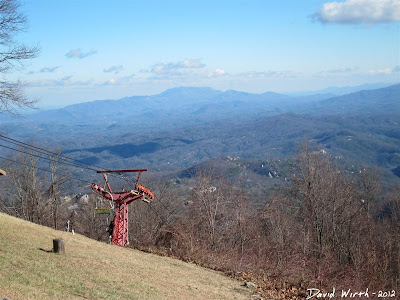 view of chair lift with smokey mountains in background
