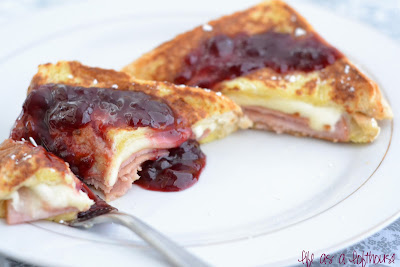 Deluxe French Toast Sandwiches are thinly sliced ham and mozzarella cheese stuffed between 2 pieces of french toast and toppedit off with raspberry jam. Life-in-the-Lofthouse.com