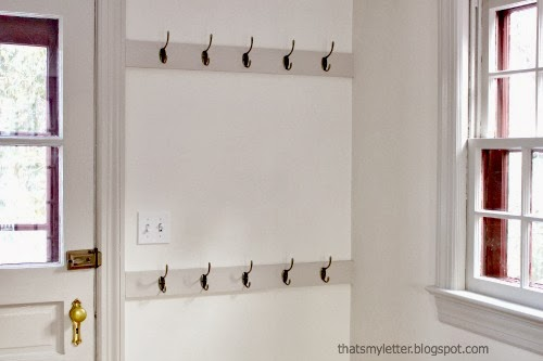 wall of hooks in mudroom