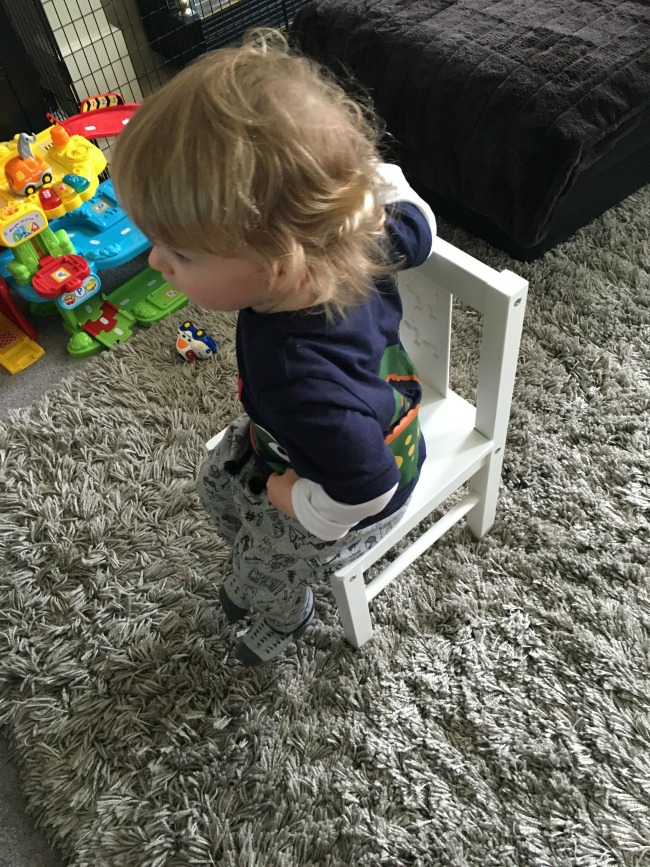 toddler sat on chair