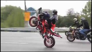 picking up the motobike