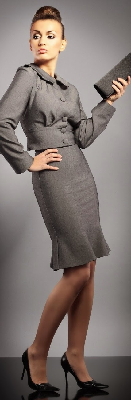 Gray suit with peplum hem.