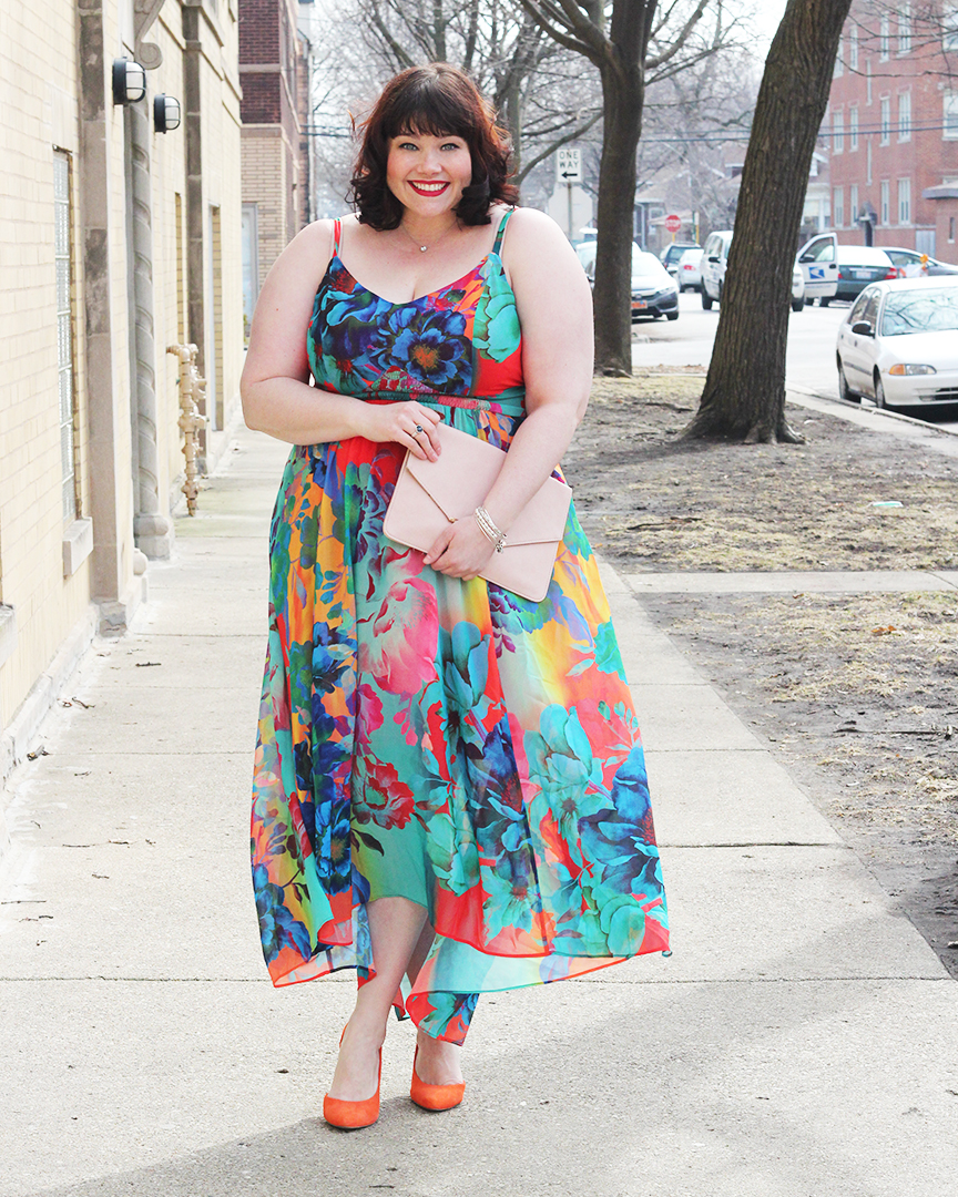 Amber from Style Plus Curves in a City Chic Floral Hi-Lo Maxi dress and orange shoes