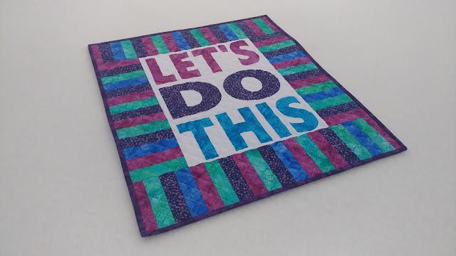 Modern mini quilt using words