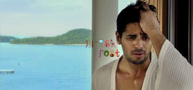 Sidharth Malhotra scratching head with sea water background