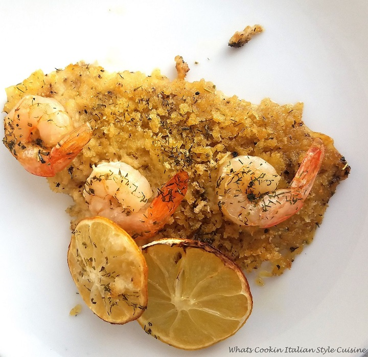 this is a flounder baked with a buttery wine sauce topped with shrimp and sliced lemon