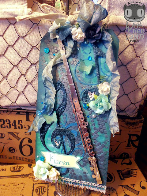 tag, handmade, custom, scrapbooking, paper crafts, gift tag, crinkle ribbon, flowers, mixed media, pearls, quartz, jewels, gems, bling, silver, aqua, teal, turquoise, flute, flute choir, music, treble clef, music note, eighth note, lace, distress ink, Tim Holtz, Marion Smith Designs, Color Lab, Heidi Swapp, Color Shine, Perfect Pearls, PearlEx, Tattered Angles, Lindy's Stamp Gang, Prima Marketing, gesso, stenciling, misting, inking, distress crackle, Gelatos, Faber Castell, embossing powder, Alice Scraps Wonderland