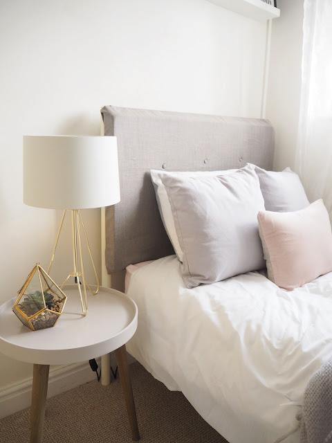 Scandinavian themed bedroom makeover featuring Scandinavian colour palette, diy headboard and budget interior ideas