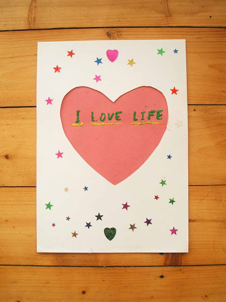 handmade illustration created with glitter and star stickers saying I love life