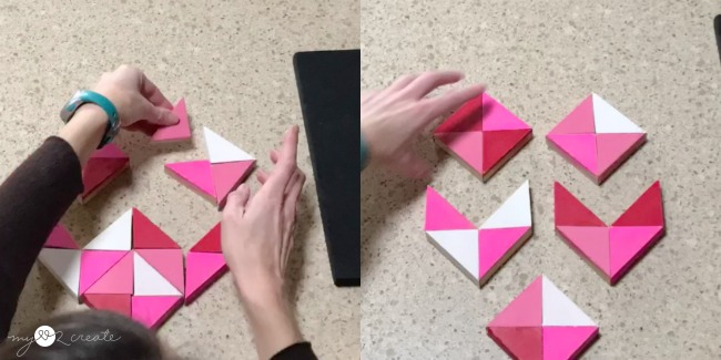 gluing together triangle wood heart pieces