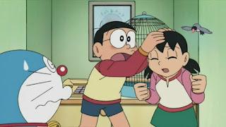 Nobita and Shizuka fighting and doraemon watching