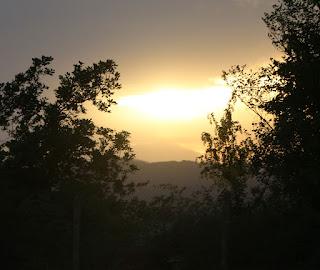 The sun descends below cloud level
