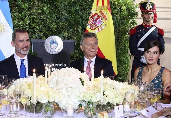Queen Letizia wore a new floral-print v-neck sleeveless midi dress by Carolina Herrera.