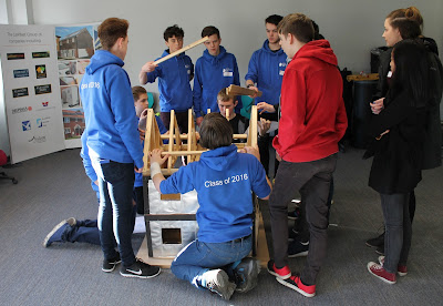 Students at GPUTC with the model house donated by Larkfleet