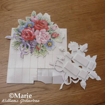 Using sticky foam pads to layer up designs for the paper tole paper craft