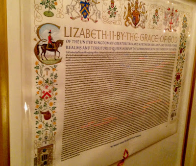 A photo of the Royal Charter of the Worshipful Company of Saddlers hanging in Saddlers' Hall in the City of London