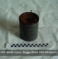 Cell-made stove with tins and wick, Boggo Road Gaol (Queensland Museum)