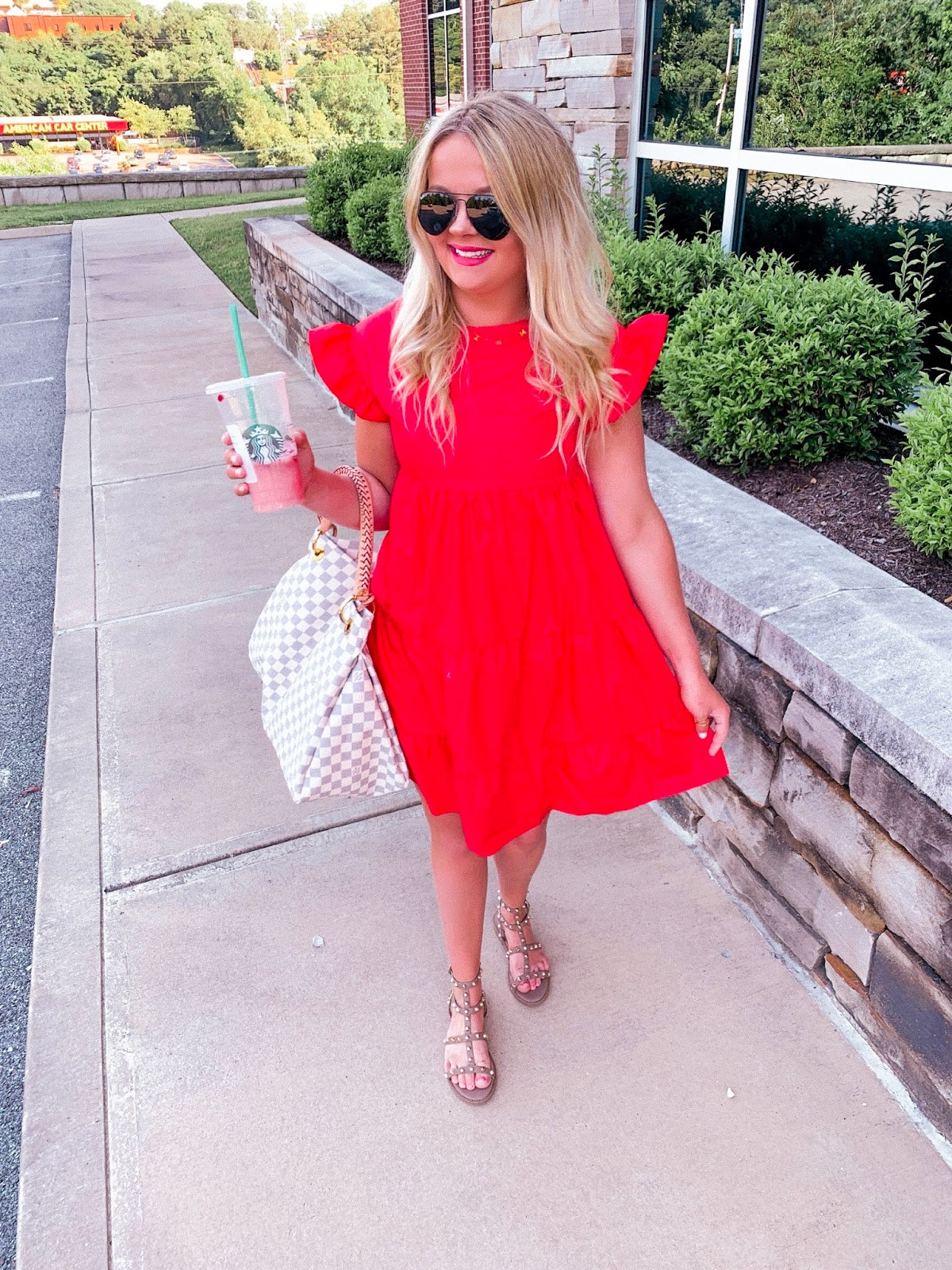 red tiered missguided dress with brown studded gladiators
