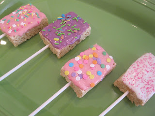 Easter Rice Krispie Pops are rice Krispie treats dipped in candy coating and covered in sprinkles and peeps. Life-in-the-Lofthouse.com