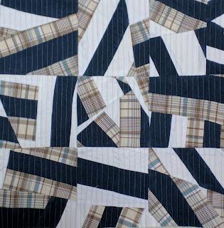 Improv pillow top of nine six-inch blocks made of three vintage men's shirts.