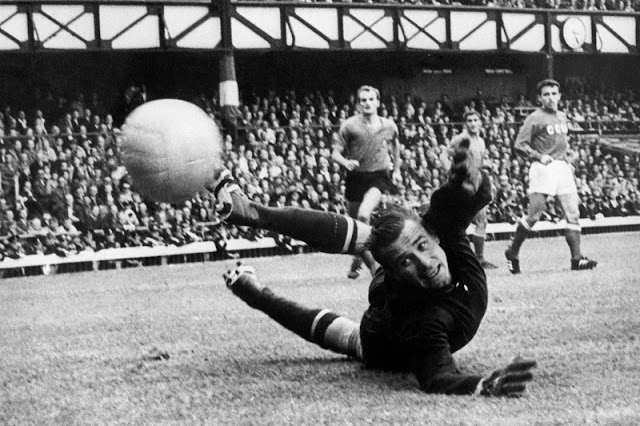 "USSR goalkeeper Lev Yashin makes a superb save after a shot from Italian forward Alessandro ""Sandro"" Mazzola at the 1966 World Cup. Italy-USSR match (16 July 1966), where Yashin saved a penalty"
